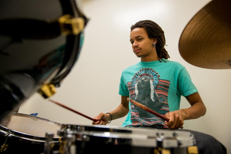 Student playing a drumset