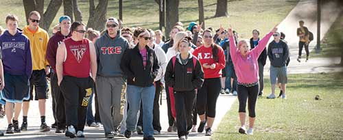 Students from various organizations walking across campus