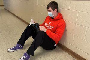 student studying hallway